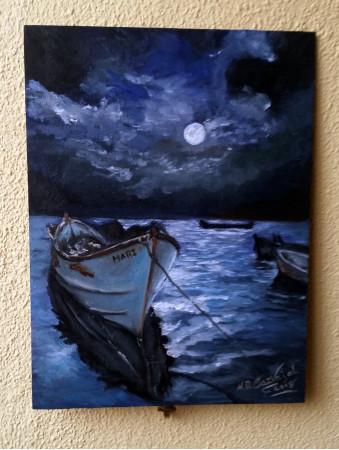 Las barca en la nochecer
